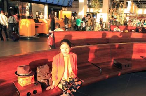 asian girl waiting at france airport sunrise soaked morning elegant chair_agirlnamedclara