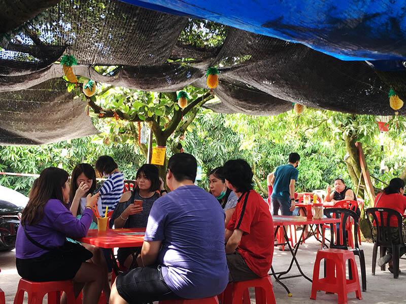 people tourist sit mango king eatery sekinchan cuti-cuti malaysia agirlnamedclara