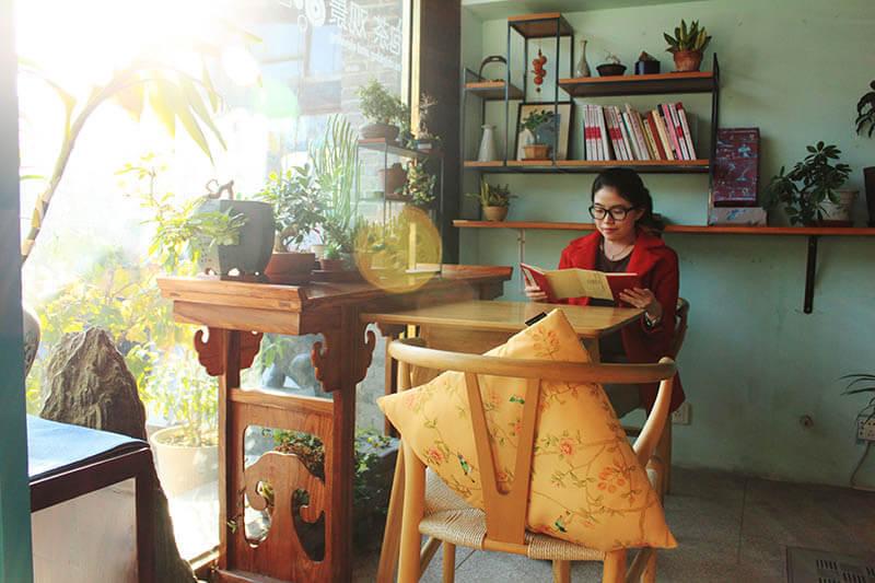woman reading a book in a chinese tea shop houhai beijing a girlnamedclara
