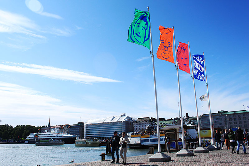colourful flags sea helsinki finland agirlnamedclara