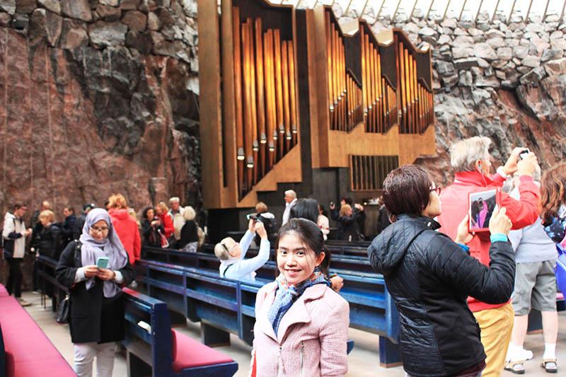 inside the rock church temppeliaukio helsinki finland girl smiling agirlnamedclara