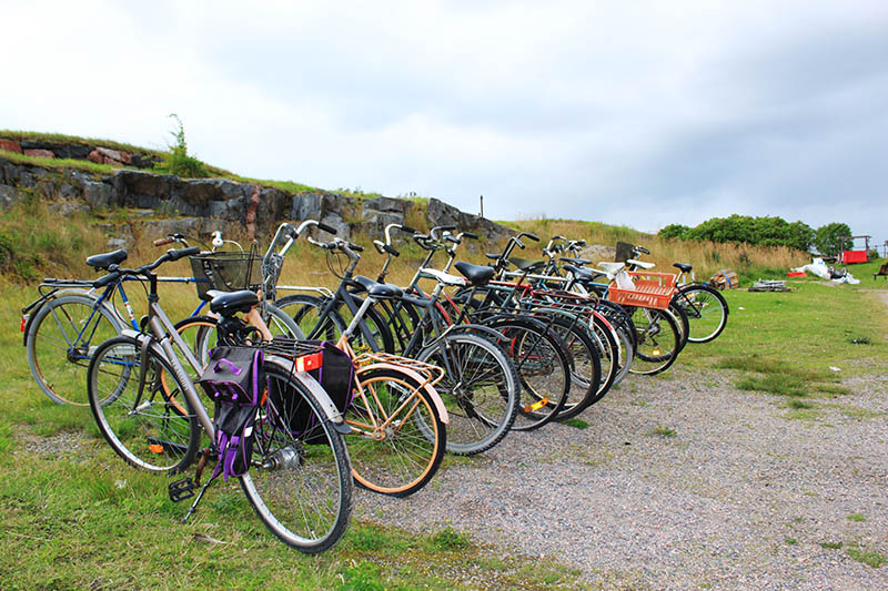 suomenlinna bicycles parked in a row grassfields agirlnamedclara