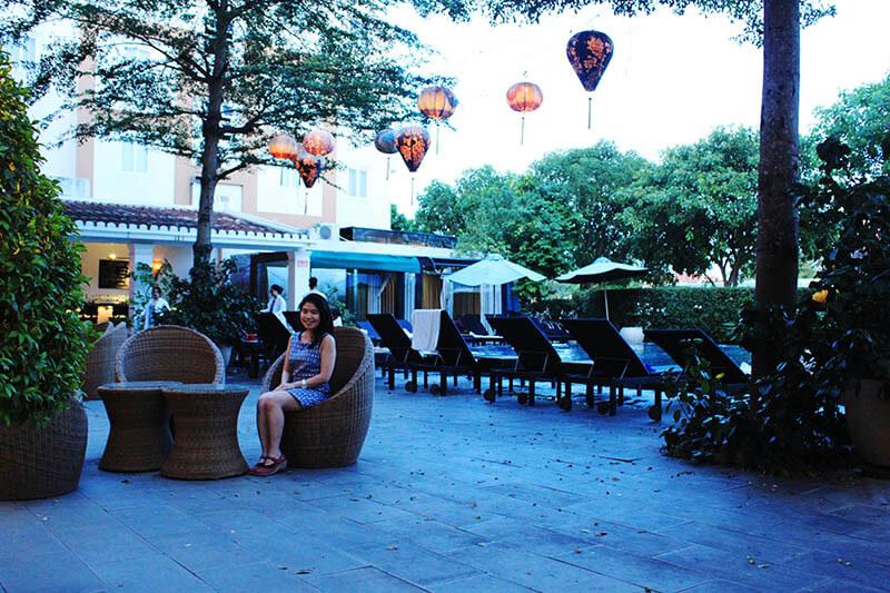 girl blue dress sit tanh binh riverside hotel hoi an swimming pool garden agirlnamedclara