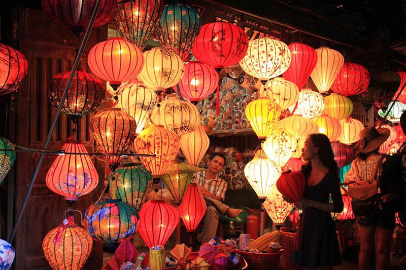girl walk pass by lantern shop hoi an night market agirlnamedclara