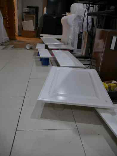cabinet doors with paint drying