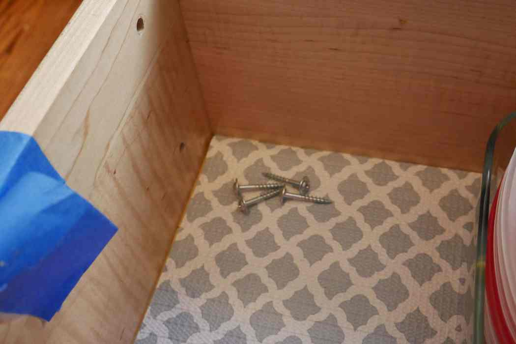 screws inside cabinet drawer