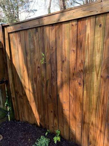 power washed fence with streak marks