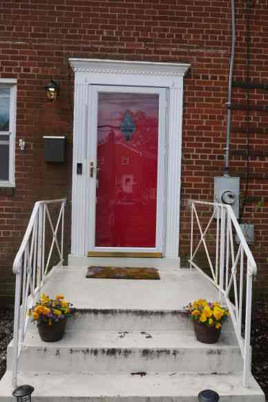 front door with glass storm door