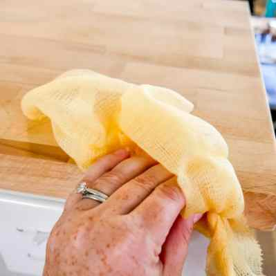 using tack cloth to wipe down the counter