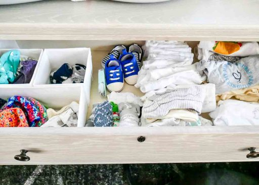 open drawer with baby clothes folded in