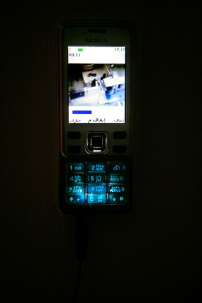 RAN, TEHERAN, JUNE 2009 / video on mobile phone with Arabic keyboard / 2009