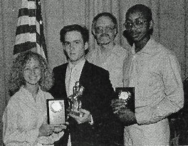 Jennifer Jacobs (left) with the other 1988 Outstanding Seniors, Chad Hood (center left), and Kevin Crawford (far right) and Bro. Neal Golden (center right)