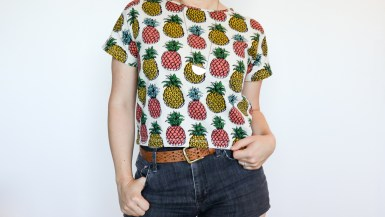 Shirt with pineapple pattern and black jean shorts