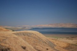 San Luis Reservoir, Central California, in drought condition in 2008, with water at 20% of capacity.  Photo by Len Wilcox