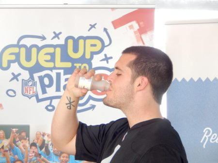 California native and Oakland Raiders quarterback Derek Carr enjoys chocolate milk at the Fuel Up to Play 60 event at the World Ag Expo. Photo by AgNet West's Sabrina Hill