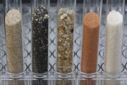 glass testing tubes with different soils