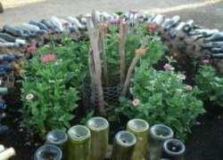 Wine bottle keyhole garden
