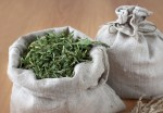 Dried fresh herbs are stored in linen bags