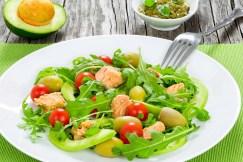 Tuna salad with arugula, green olives, avocado and cherry tomato