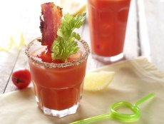 Bloody mary cocktail with bacon and celery.