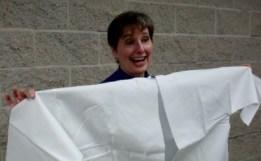 Gail Rubin displays Jewish burial garments in her talk.