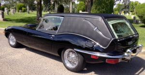 Jaguar hearse in cemetery