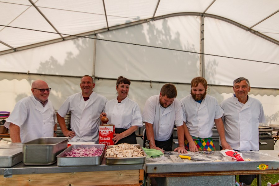 The Agoonoree kitchen volunteers making pizzas in the kitchen tent