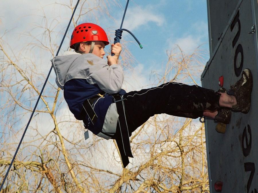 Scout rock climbing