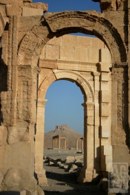 Arches, pillars and castle of ruins in Palmyria Syria.