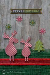 Rustic Merry Christmas Card with Reindeer, Tree and Snowflakes on Red Ribbon and Green Burlap - Vertical
