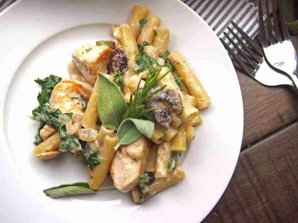 View of Chicken, mushroom, and kale pasta bake with sage and rosemary