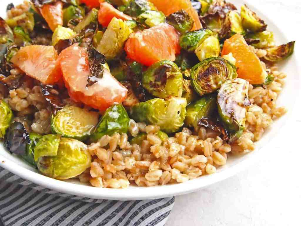 Close up of farro salad with brussels sprouts and citrus