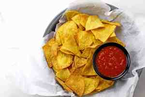 Overview of basket of chips with salsa