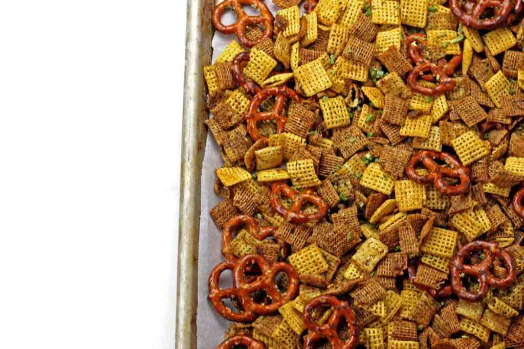 Ranch chex mix cooling on a sheet pan