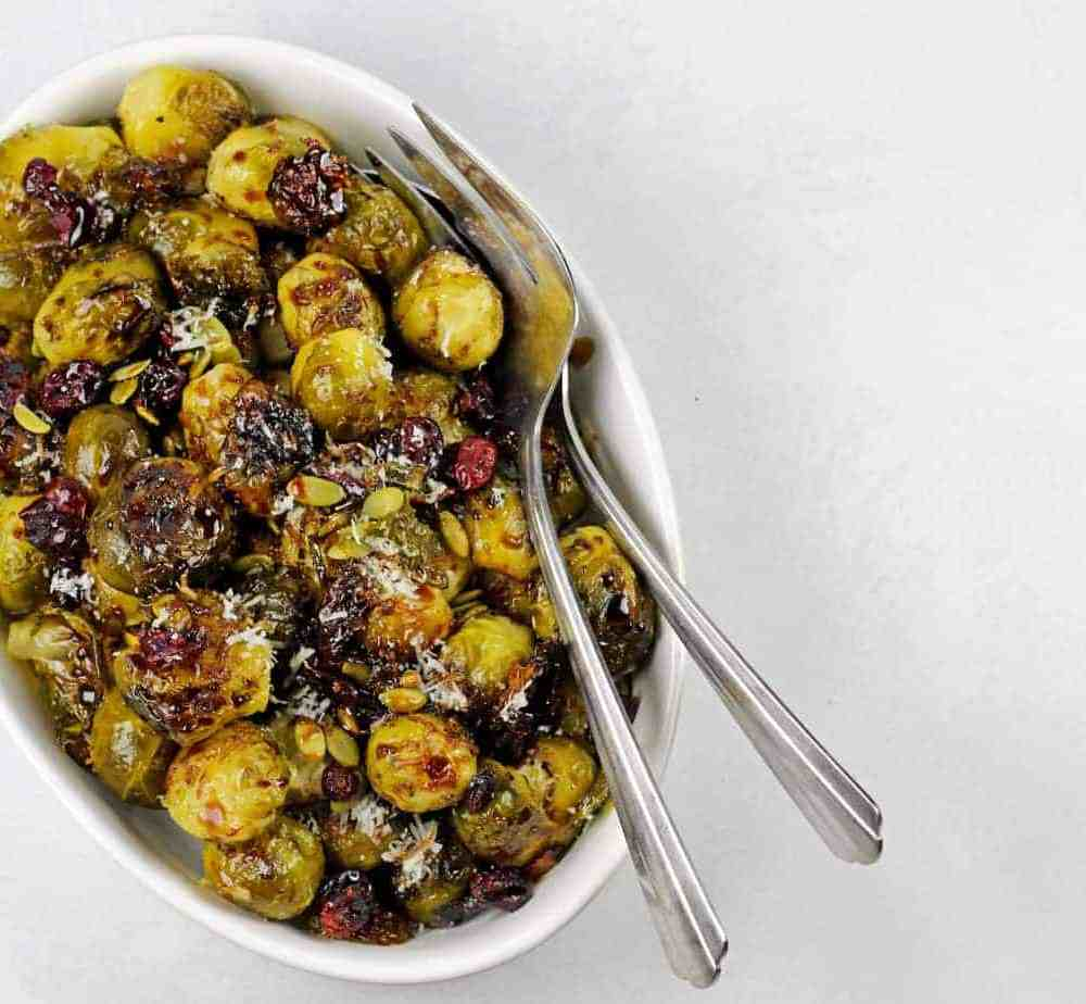 Smashed Brussels Sprouts with Balsamic Glaze, Pepitas, and Cranberries