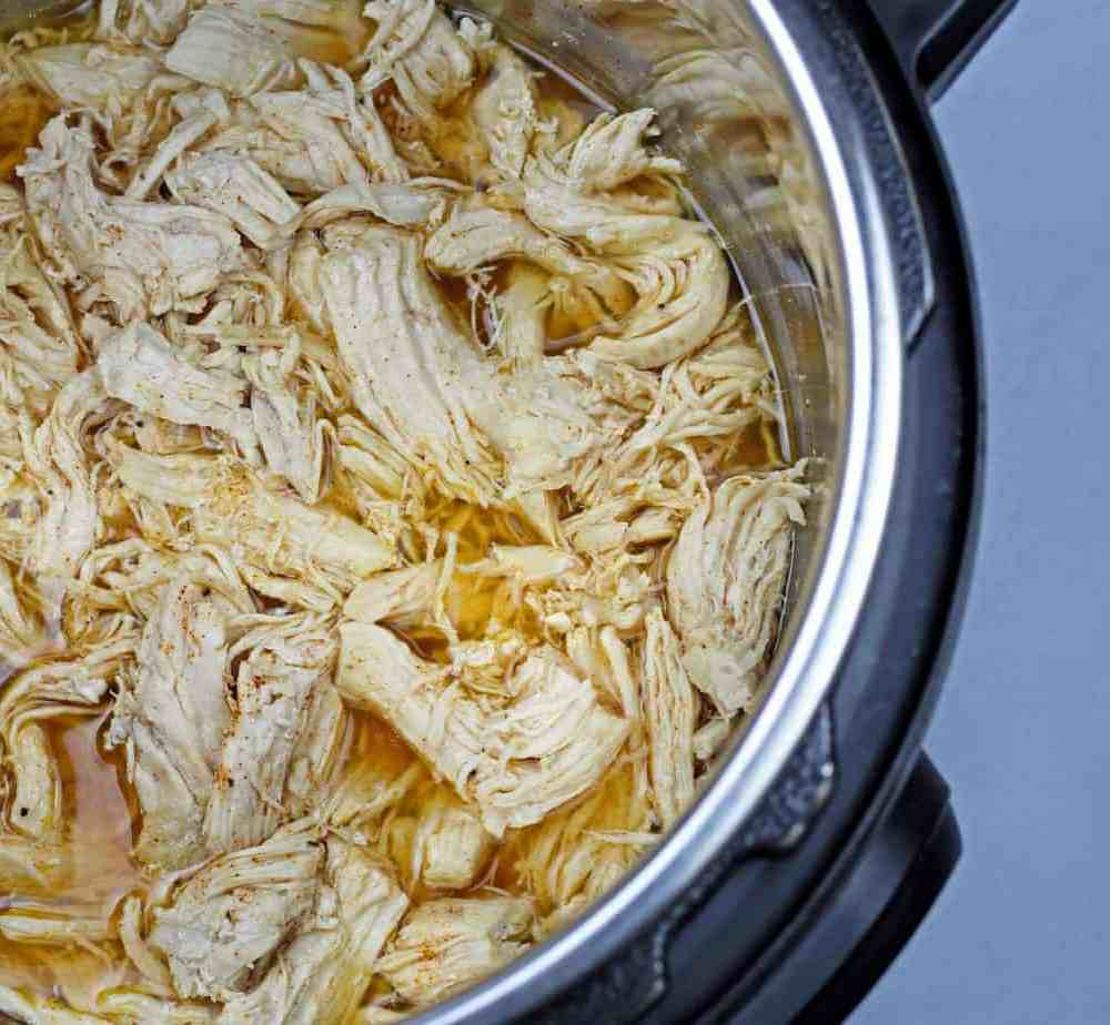 Overview of instant pot shredded chicken in the instant pot bowl.