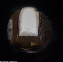 Peeking through into the room below the belltower