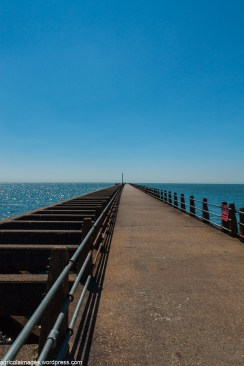 The pier to east of the entrance to the port of Newhaven.