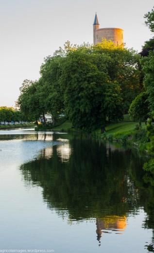 Dusk in Bruges on the canal at Gentport southwest
