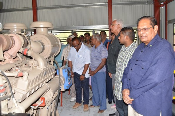 Prime Minister Moses Nagamootoo and Minister of Agriculture Noel Holder look on as the drainage pump at Joppa, Number 43 Corentyne Berbice Region Six is being switched on