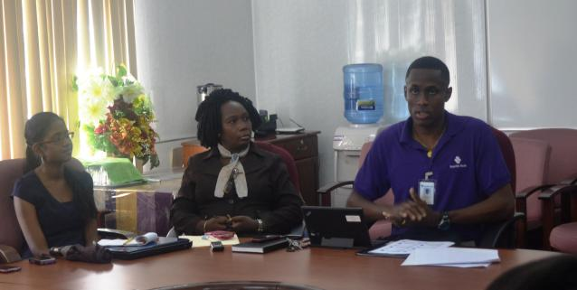 Deputy Permanent Secretary Ms Joylyn Burrows -Administrative (centre) with Republic Bank rep. (right) and M and E Unit staff during the workshop