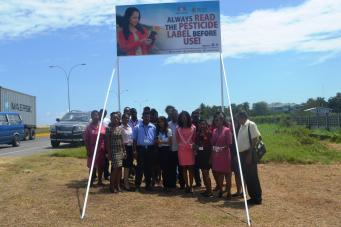 staff-of-the-ptccb-infront-of-the-newly-erected-billboard