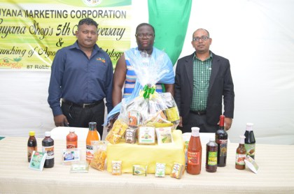 (From Left) Guyana Shop Manager Kevin Macklingam, General Manager of the Guyana Marketing Corporation Ida Sealy-Adams and Interim Chairman of the GMC's Board Omadatt Chandan.