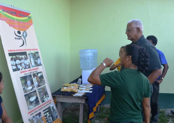 Ms. Torres gives Minister Holder a description of some of the facility's operations