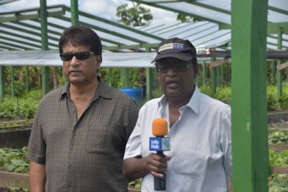 Dr. Homenauth along with farm owner Rameesh Ramraptan.