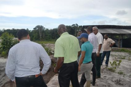 Minister Holder and other officials during the visit to farms in the Laluni area