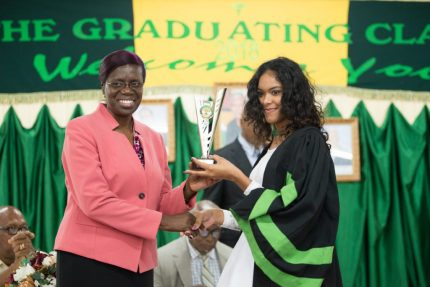 Permanent Secretary of the Ministry of Agriculture, Delma Nedd presents the trophy for 'Best overall performance' in the Agriculture Diploma Course to Alleema Shahabudeen