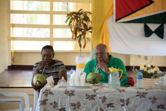 Minister of Education, Hon. Dr. Nicolette Henry and Minister of Finance, Hon. Winston Jordan enjoying some Pomeroon Coconut Water
