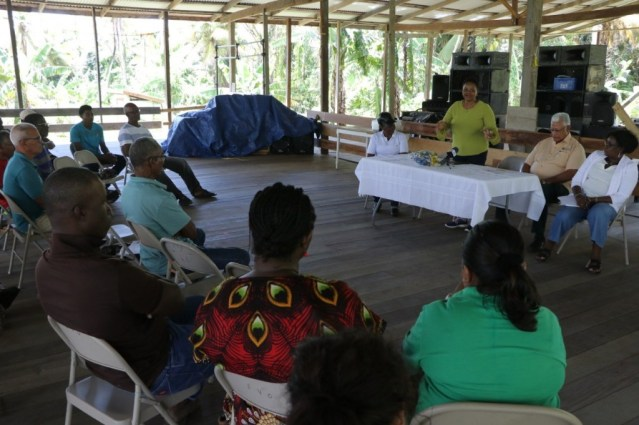 Minister of Public Health, Volda Lawrence addressing the coconut farmers during a community meeting at Grant Regina in the Lower Pomeroon