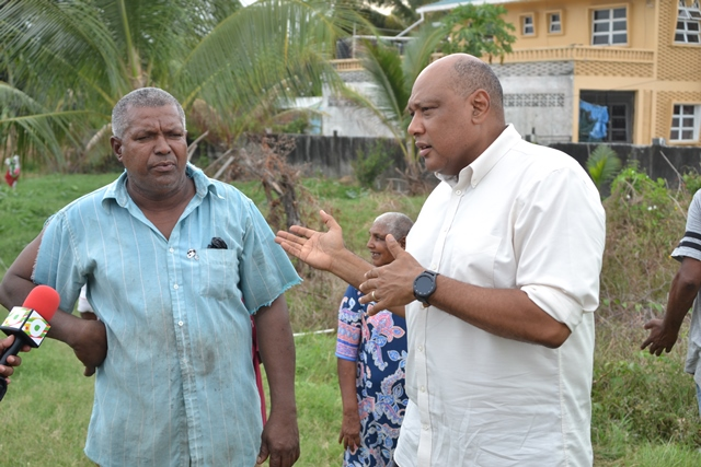 Minister of Natural Resources, Hon. Raphael Trotman speaking with resident Lloyd Alphonso